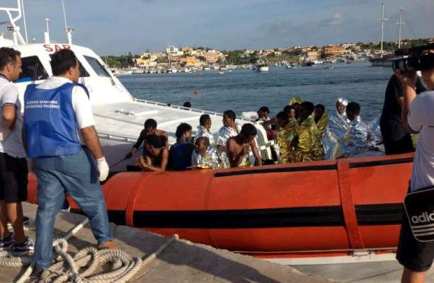The Italian coastguard brings survivors of Thursday's tragedy to the harbour in Lampedusa. © AMSA